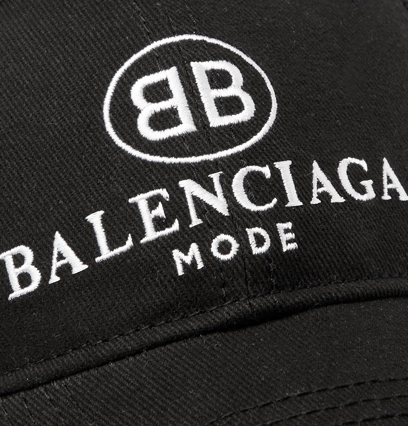 a070bc86 The subversive designer Demna Gvasalia has brought a new era at Balenciaga,  not least in the way he consistently reinvents the logo. This cotton-twill  cap, ...
